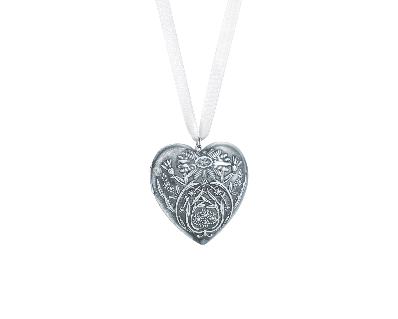 1ffce9e7c Ziegfeld heart locket of sterling silver with daisy motif. $ 800.