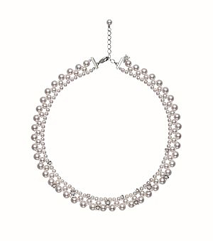 The Flower Lace necklace features a delicate lace design.